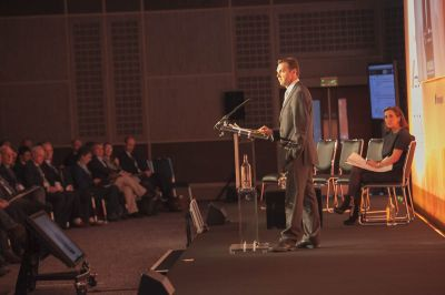 Tim speaking at the RunwaysUK event in London. Image credit: Runways UK